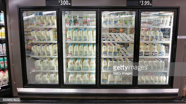 Fridges stocked with milk are seen in a Woolworths supermarket on May 24 2016 in Sydney Australia Australians are rallying around it's dairy farmers...