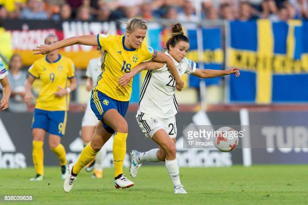 Fridolina Rolfoe of Sweden and Lina Magull of Germany battle for the ball l during the Group B match between Germany and Sweden during the UEFA...