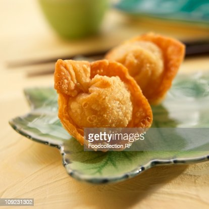 Fried Asian dumplings on plate, close-up : Stock Photo