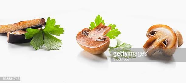 Fried aubergine and mushrooms with parsley