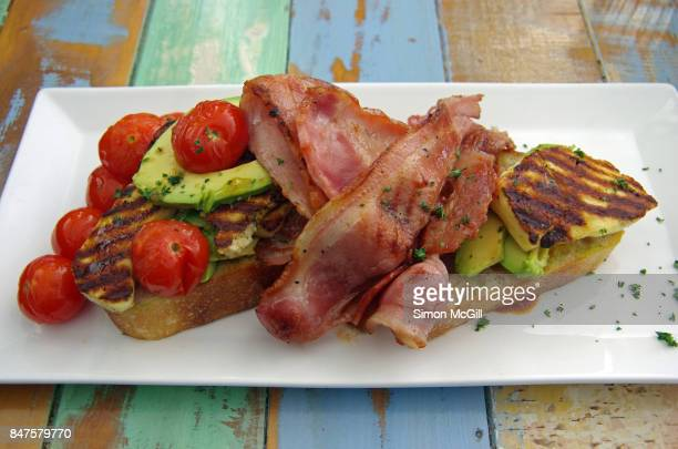 Fried bacon, grilled halloumi cheese, raw avocado and roasted cherry tomatoes served on toasted soughdough bread