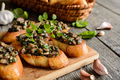 Fried baguette slices with mushrooms, garlic and herbs