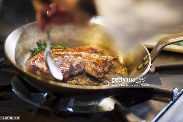 Fried beef steak in a pan