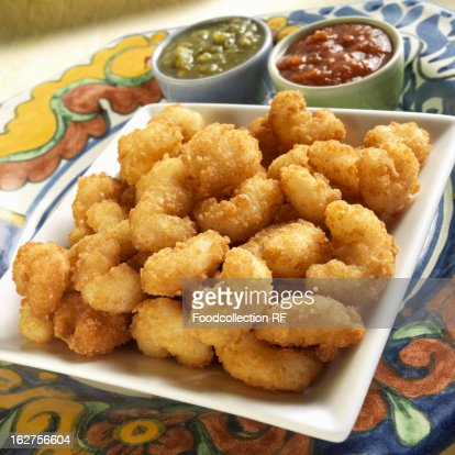 Fried breaded shrimp with chili sauce and tomatillo salsa : Stock Photo