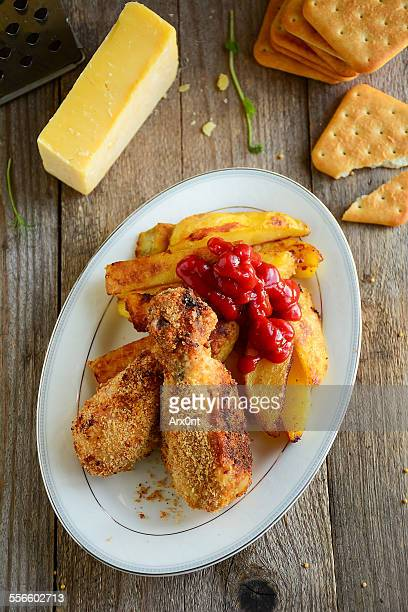 Fried chicken legs with potato wedges