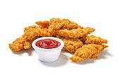 High resolution digital capture of a serving of crispy, golden, fried chicken strips, with ketchup, on a pure white background.