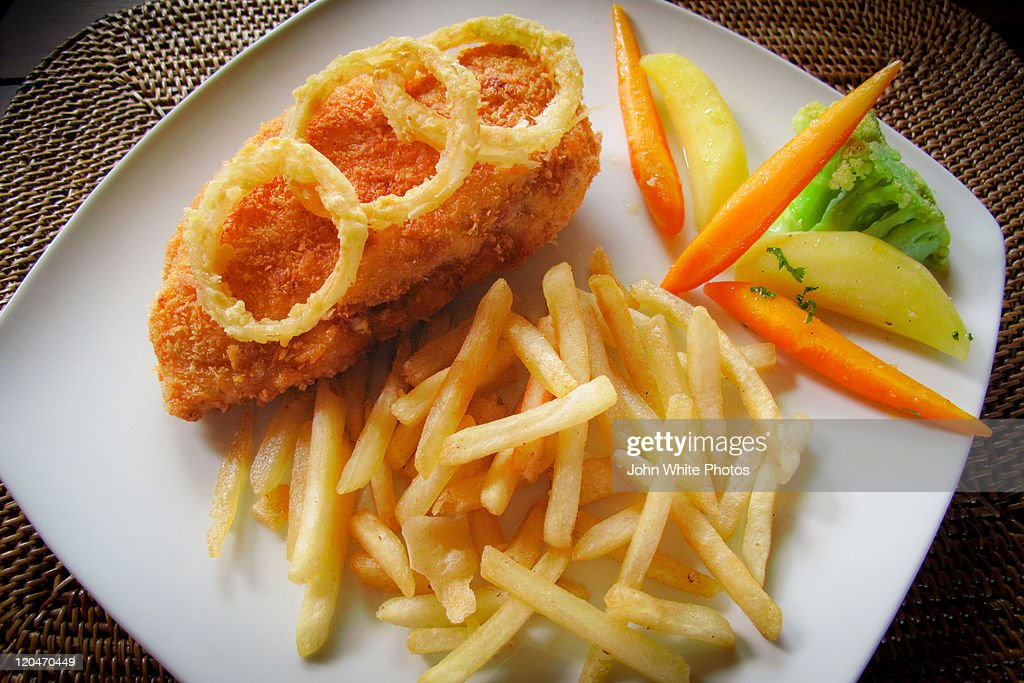 Fried chicken with onion rings and hot chips : Stock Photo