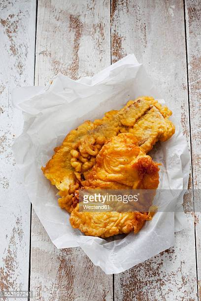 Fried coalfish on waxed paper