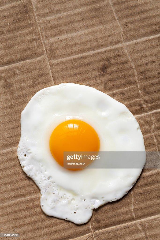 Fried egg on cardboard