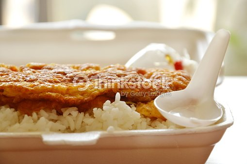 fried egg on rice in foam box with plastic spoon : Stock Photo
