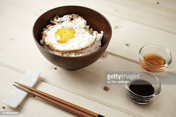 Fried egg on rice with sesame oil & soy seasoning