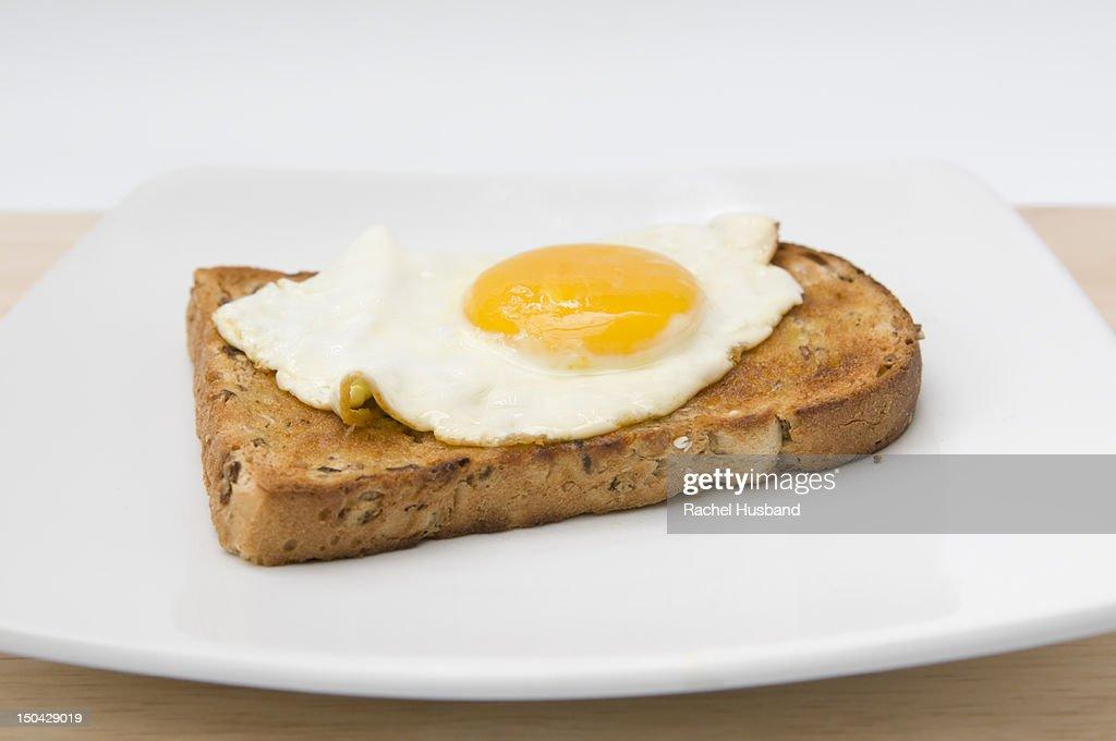 Fried egg on slice of granary toast