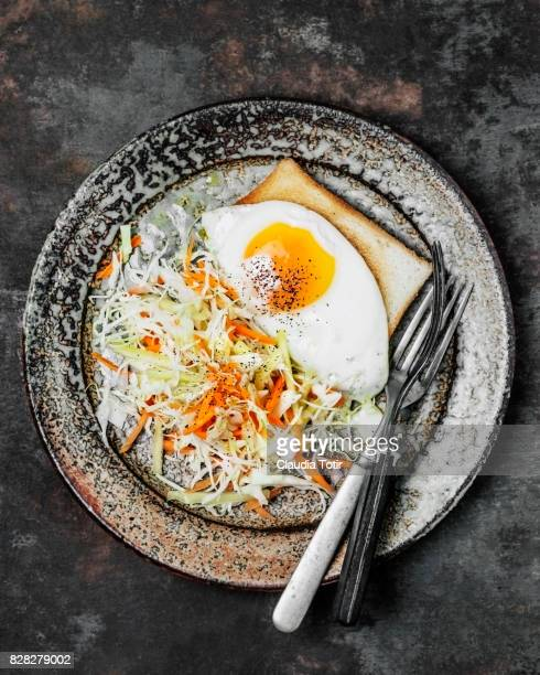Fried egg with salad