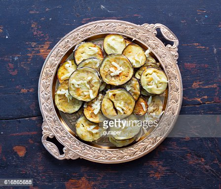 fried eggplant with garlic in a golden plate : Stock Photo