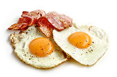 fried eggs and bacon slices isolated on white background