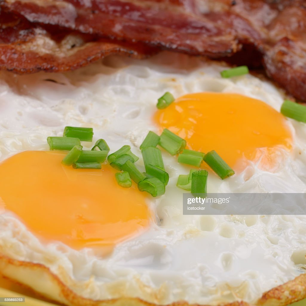 Fried eggs with bacon : Stock Photo