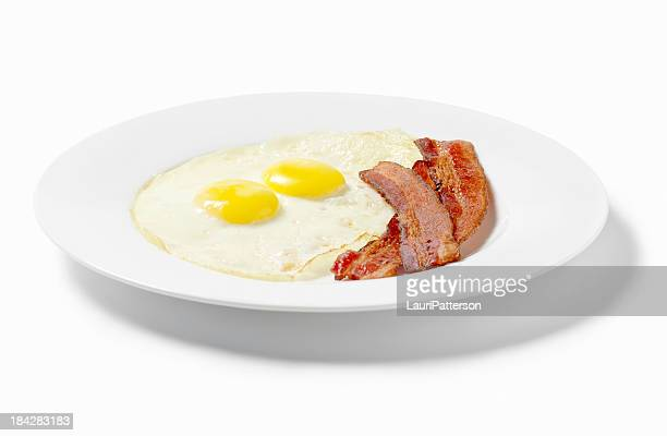 Fried Eggs with Strips of Bacon