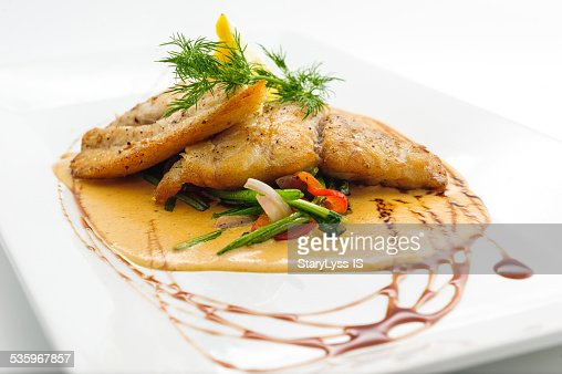 Fried fish fillet with sauce : Stock Photo