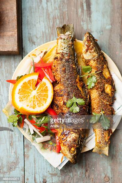 Fried Fish with coriander and fresh salads