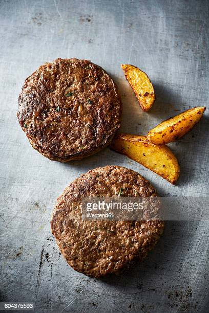 Fried ground beef, burger and potato wedges