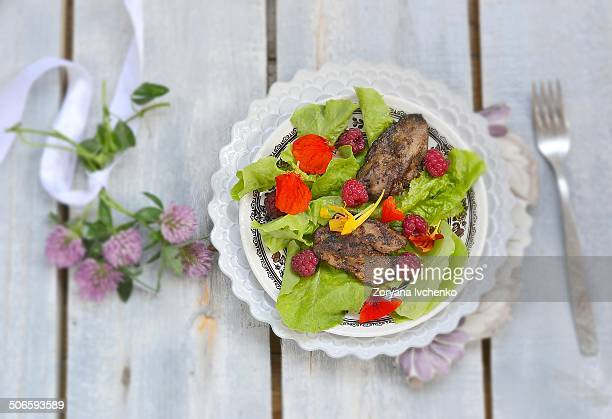 Fried liver and raspberry salad