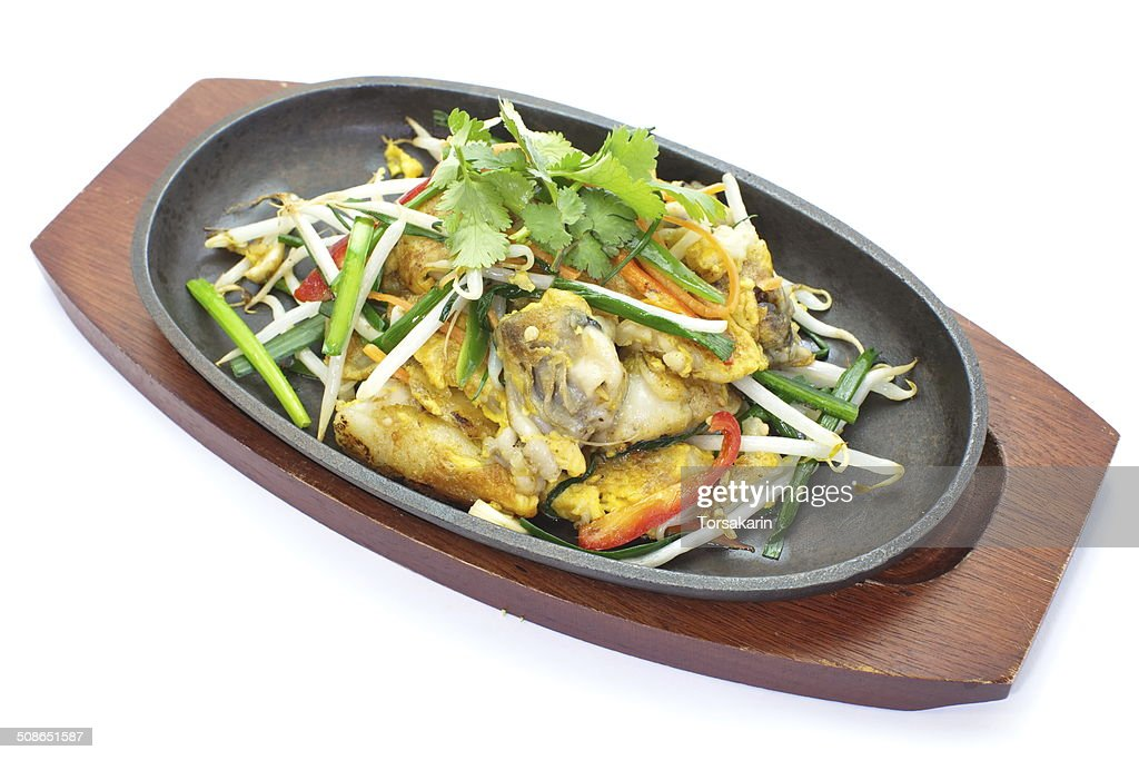 fried mussel pancakes and vegetables in hot plate : Stock Photo