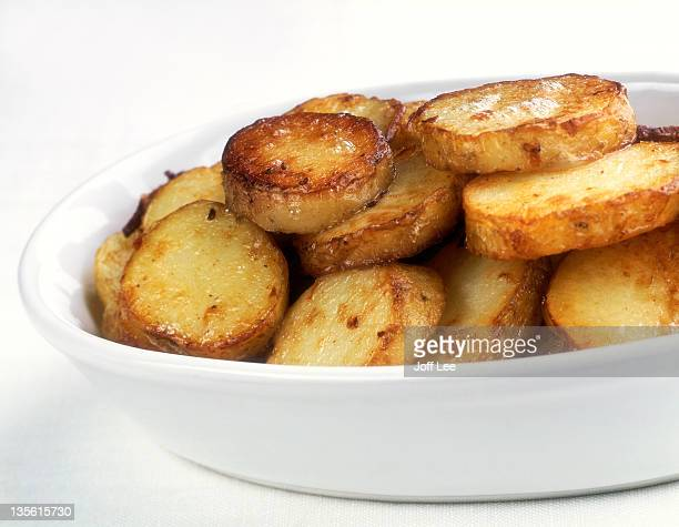 Fried potatoes in white bowl