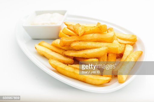 Fried potatoes on white plate : Stock Photo