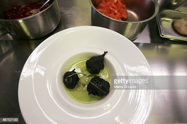 Fried Shallot with squid ink tempura clams and courgette prepared by Master Chef Moreno Cedroni of the La Madonnina del Pescatore of Senigallia...