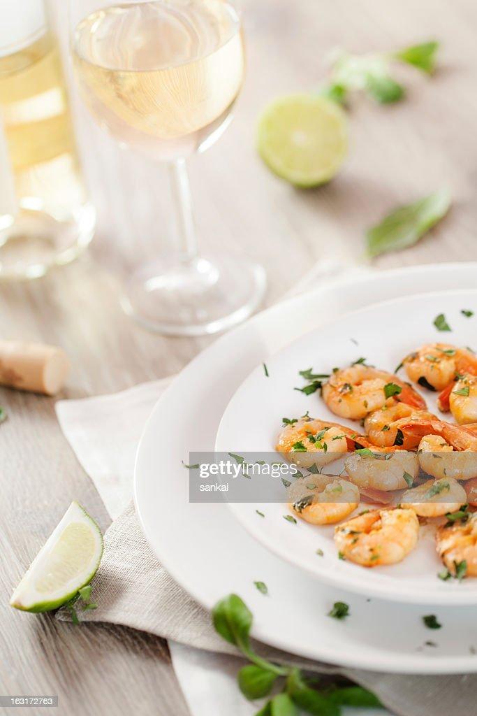 Fried shrimp and white wine : Stock Photo
