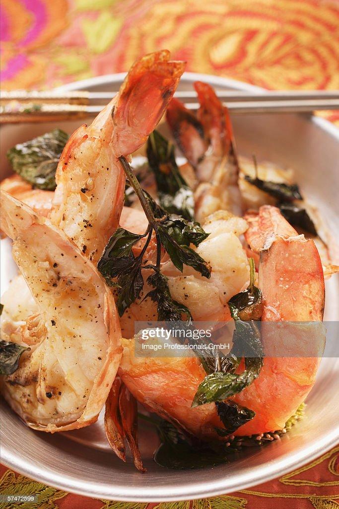 Fried shrimps with Thai basil : Stock Photo