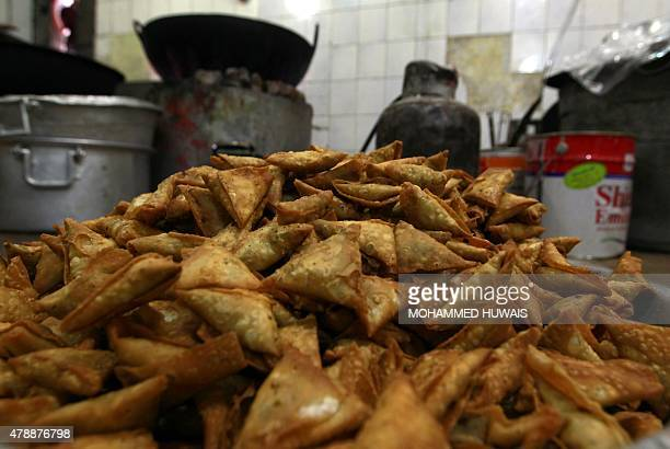 Fried Yemeni 'sambusa' or samosa is prepared at a shop during the Muslim holy fasting month of Ramadan in the capital Sanaa on June 28 2015 AFP PHOTO...