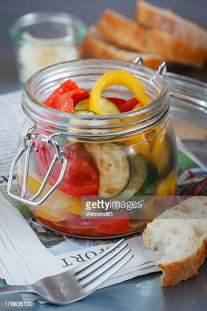 Fried zucchini pepper salad in glass jar