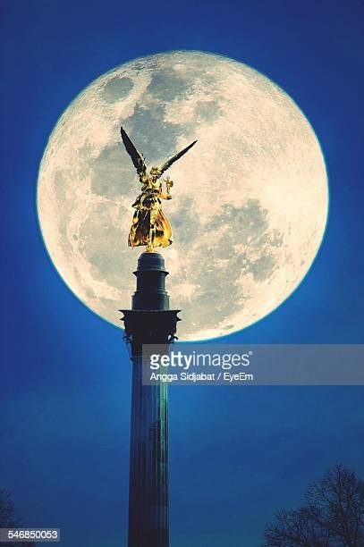Friedensengel Statue Against Majestic Full Moon