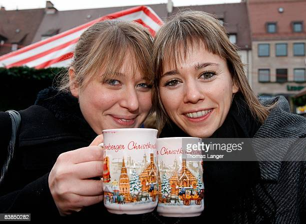 Friederike and Simone from Nuremberg drink Gluehwein prior to the opening ceremony of the Christmas Market on November 28 2008 in Nuremberg Germany...