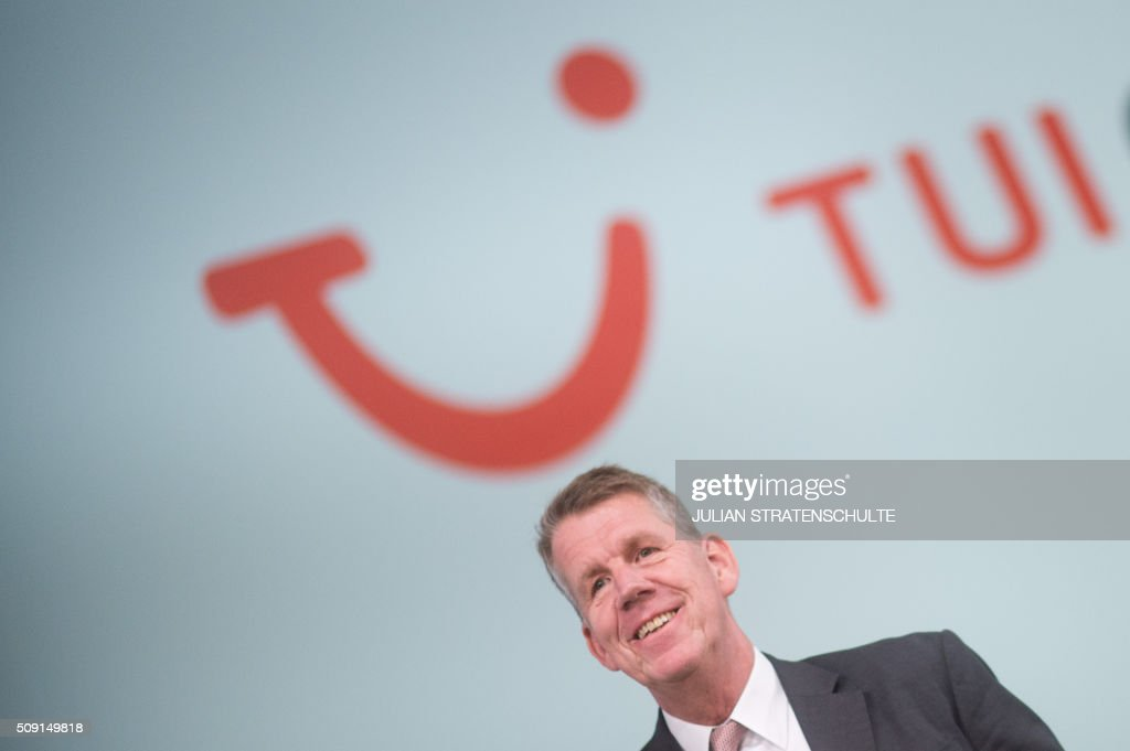 Friedrich Joussen, chairman of the world's biggest tourism group TUI, stands in front of his company's logo during the TUI annual general meeting in Hanover, central Germany, on February 9, 2016. TUI said that it seen bookings to Turkey drop by 40 percent in the wake of the Istanbul attack, but hopes to meet its 2016 goals nevertheless. / AFP / dpa / Julian Stratenschulte / Germany OUT