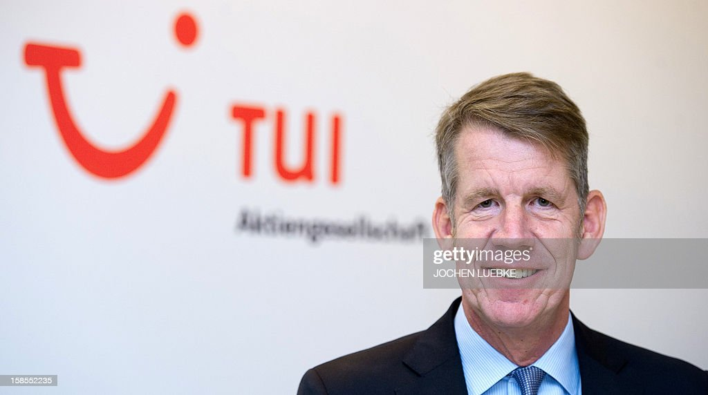 Friedrich Joussen, designated chairman of German tourism giant TUI, poses in front of his company's logo on the sidelines of a press conference in Hanover, central Germany, on December 19, 2012. TUI posted a net loss for the 2012 financial year due to difficulties at shipping company Hapag Lloyd in which it holds a stake.
