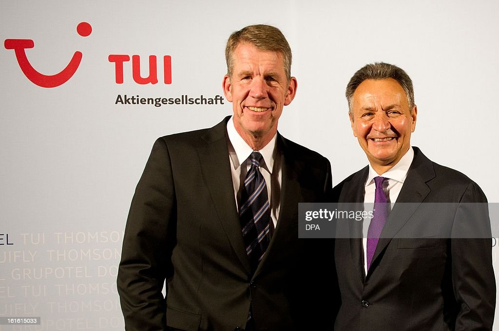 Friedrich Joussen (L) future managing director of German tourism giant TUI and the outgoing managing director Michael Frenzel (R) pose during the company's gerneral meeting in Hanover,northern Germany, on February 13, 2013. TUI, which operates its business year from October to September, said in a statement it booked a net loss of 137 million euros ($184 million) in the three months to December, compared with a loss of 87.6 million euros a year earlier.