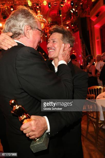 Friedrich von Thun congrats Tobias Moretti during the ROMY award at Hofburg Vienna on April 22 2017 in Vienna Austria