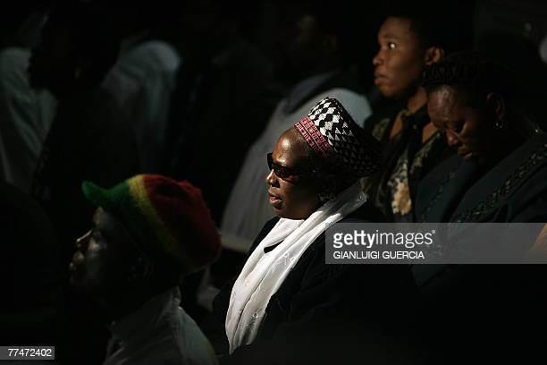 Friend and relatives of South African reggae musician Lucky Dube attend 24 October 2007 his memorial service at the Bassline music club in downtown...