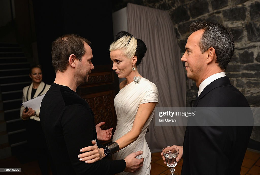 Friend of the Roger Dubuis brand <a gi-track='captionPersonalityLinkClicked' href=/galleries/search?phrase=Daphne+Guinness&family=editorial&specificpeople=213037 ng-click='$event.stopPropagation()'>Daphne Guinness</a> talks to Alvaro Maggini (L), Creative Director at the Excalibur Dinner during the 23rd Salon International de la Haute Horlogerie at Caves des Vollandes on January 22, 2013 in Geneva, Switzerland.
