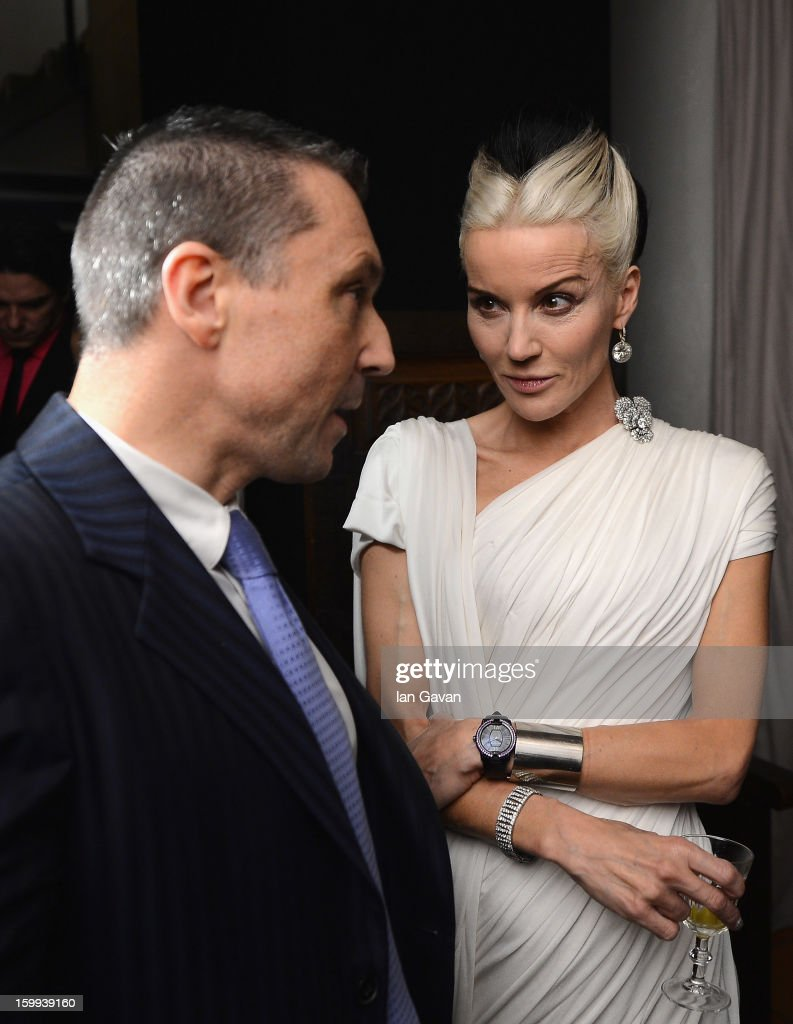 Friend of the Roger Dubuis brand Daphne Guinness talks with CEO Jean-Marc Pontroue at the Excalibur Dinner during the 23rd Salon International de la Haute Horlogerie at Caves des Vollandes on January 22, 2013 in Geneva, Switzerland.