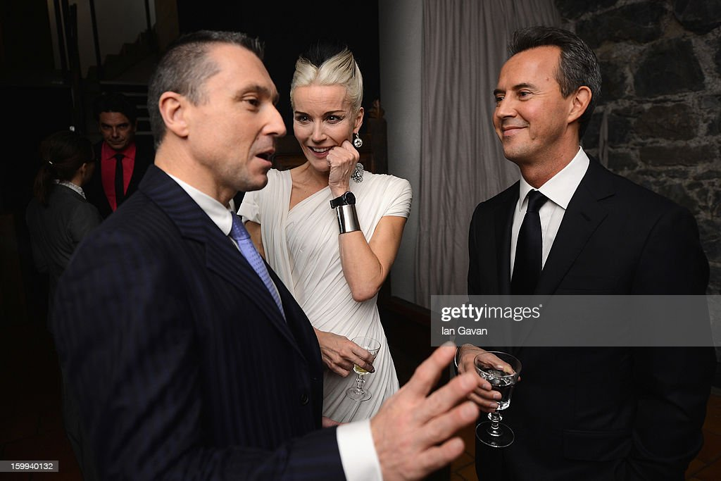 Friend of the Roger Dubuis brand <a gi-track='captionPersonalityLinkClicked' href=/galleries/search?phrase=Daphne+Guinness&family=editorial&specificpeople=213037 ng-click='$event.stopPropagation()'>Daphne Guinness</a> (C) talks with CEO Jean-Marc Pontroue (L) at the Excalibur Dinner during the 23rd Salon International de la Haute Horlogerie at Caves des Vollandes on January 22, 2013 in Geneva, Switzerland.