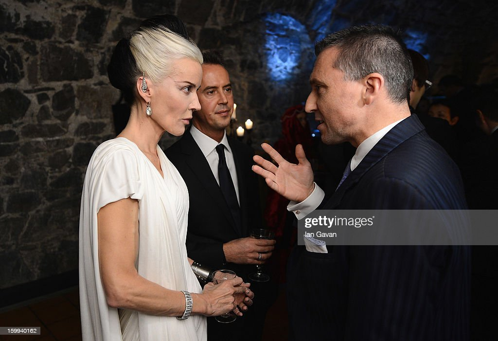Friend of the Roger Dubuis brand <a gi-track='captionPersonalityLinkClicked' href=/galleries/search?phrase=Daphne+Guinness&family=editorial&specificpeople=213037 ng-click='$event.stopPropagation()'>Daphne Guinness</a> talks with CEO Jean-Marc Pontroue (R) at the Excalibur Dinner during the 23rd Salon International de la Haute Horlogerie at Caves des Vollandes on January 22, 2013 in Geneva, Switzerland.
