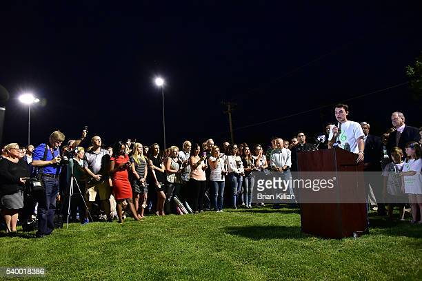 Friend Pete Marotta speaks to the crowd during the Vigil For Christina Grimmie at Evesham Memorial Complex on June 13 2016 in Evesham New Jersey