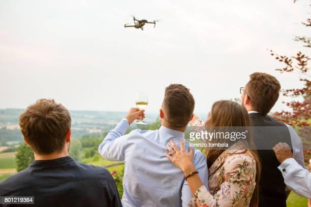 Friend toasting in wine under drone