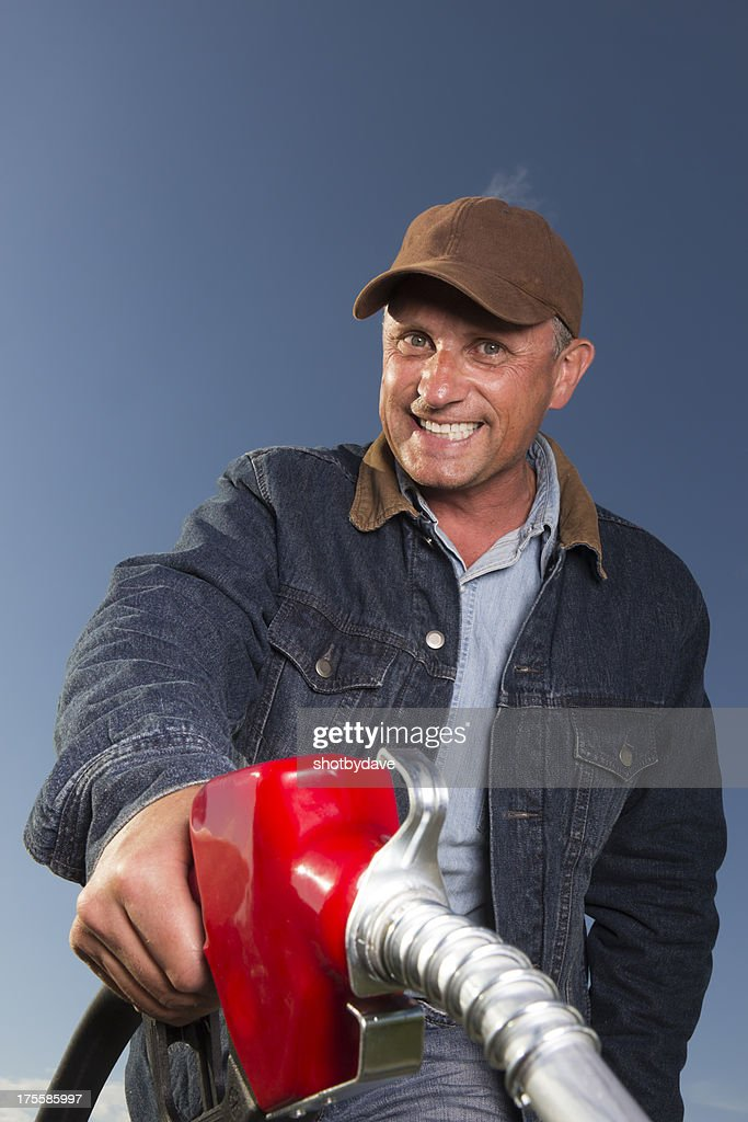 Friendly at the Pump : Stock Photo
