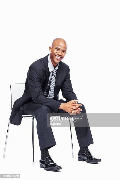 Friendly business man sitting in chair