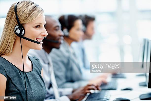 Friendly call center employees using computers