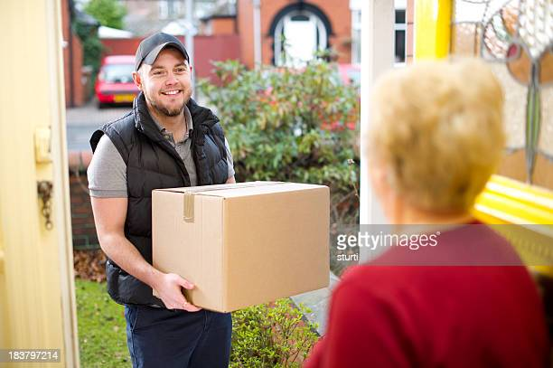 Friendly delivery man delivers parcel